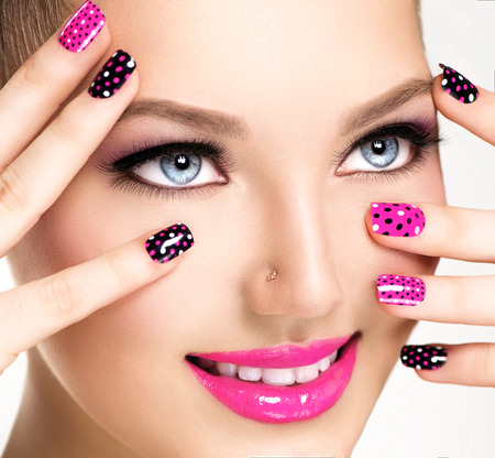 Foto de Woman portrait close up. Bright Colors. Manicure and makeup - Imagen libre de derechos