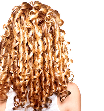 Foto de Beauty girl with blonde curly hair. Long permed hair - Imagen libre de derechos
