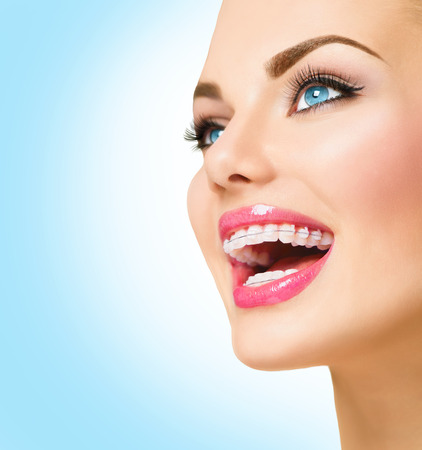 Photo for Beautiful woman smiling. Closeup ceramic braces on teeth - Royalty Free Image