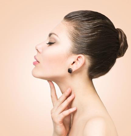 Foto de Beauty portrait. Beautiful spa woman touching her face - Imagen libre de derechos