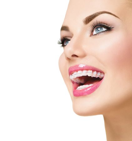 Photo pour Beautiful woman smiling. Closeup ceramic braces on teeth - image libre de droit