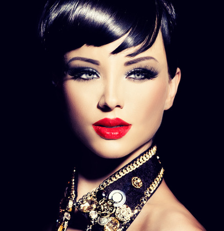 Foto de Beauty fashion model girl with short hair. Rocker style brunette - Imagen libre de derechos