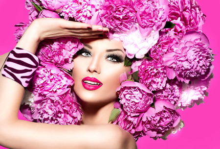 Photo pour Beauty fashion model girl with pink peony hairstyle - image libre de droit
