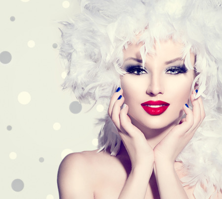 Photo for Beauty fashion model girl with white feathers hairstyle - Royalty Free Image