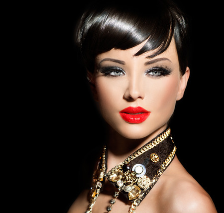 Beauty fashion model girl with short hair. Rocker style brunette