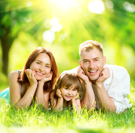 Photo pour Happy joyful young family having fun in summer park - image libre de droit