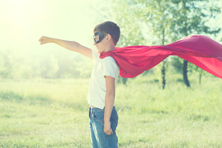Foto de Little boy wearing superhero costume outdoor - Imagen libre de derechos
