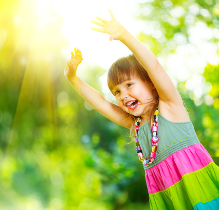 Foto de Happy little girl having fun outdoors - Imagen libre de derechos