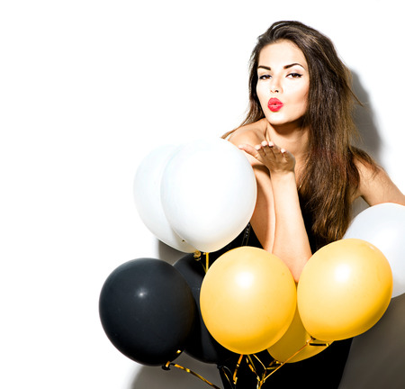 Photo pour Beauty fashion model girl with colorful balloons isolated on white - image libre de droit