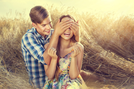 Photo pour Happy couple having fun outdoors on wheat field, love concept - image libre de droit