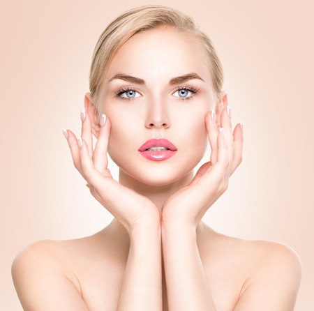 Photo for Beauty woman portrait. Beautiful spa girl touching her face - Royalty Free Image