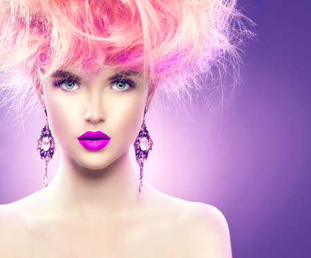 Foto de High fashion model girl with updo hairstyle and stylish makeup - Imagen libre de derechos