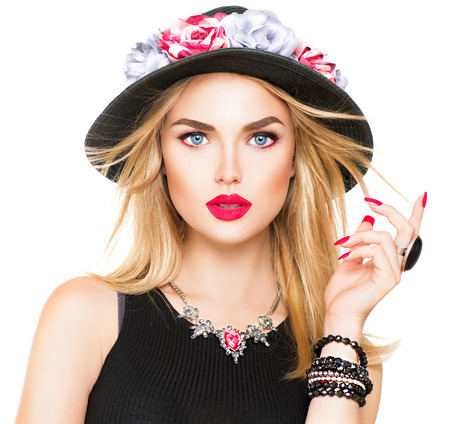 Foto de Beautiful sexy blonde woman with red lips and manicure in modern black hat - Imagen libre de derechos