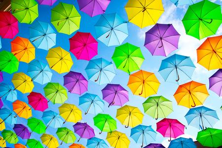 Foto de Hanging multicolored umbrellas over blue sky. Abstract background - Imagen libre de derechos