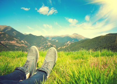 Foto de Hiker enjoying the view of nature. Meadow and mountains - Imagen libre de derechos