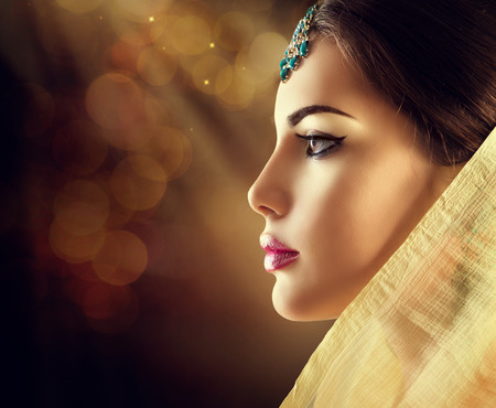 Photo for Beautiful fashion Indian woman profile portrait with oriental accessories - Royalty Free Image