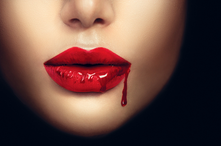 Photo pour Sexy vampire woman lips with dripping blood - image libre de droit