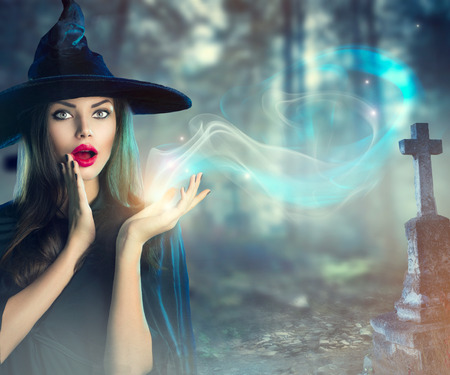 Photo for Halloween witch at a dark old spooky cemetery - Royalty Free Image