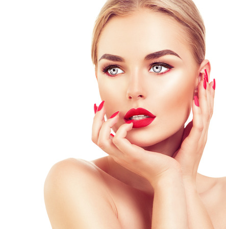 Photo pour Beautiful fashion model woman with blond hair, red lipstick and nails - image libre de droit
