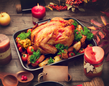 Photo for Roasted turkey garnished with potato, vegetables and cranberries. Thanksgiving or Christmas dinner - Royalty Free Image