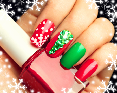 Photo pour Christmas winter holiday nail art manicure - image libre de droit
