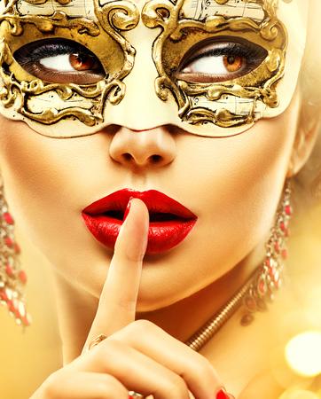 Foto de Beauty model woman wearing venetian masquerade carnival mask at party - Imagen libre de derechos