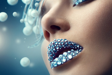 Photo pour Christmas girl. Holiday makeup with gems on lips - image libre de droit