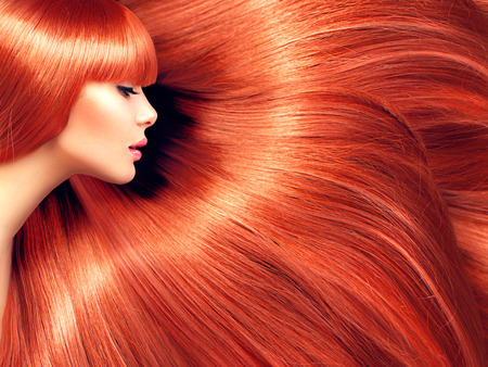 Photo pour Beautiful hair. Beauty woman with long red hair as background - image libre de droit