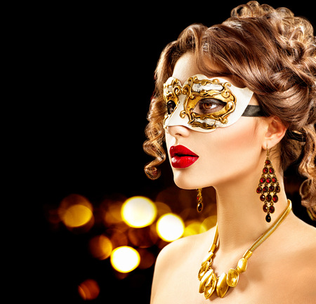 Foto de Beauty model woman wearing venetian masquerade carnival mask at party - Imagen libre de derechos