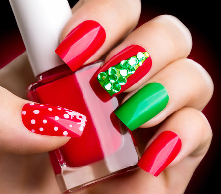 Photo pour Christmas winter holiday nail art manicure - image libre de droit