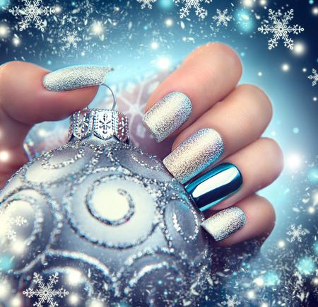 Photo pour Christmas nail art manicure. Winter holiday style bright manicure design - image libre de droit