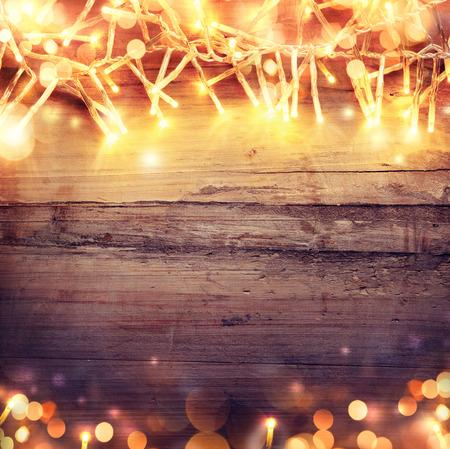 Foto de Christmas wooden background with light garland - Imagen libre de derechos