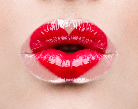 Photo for Valentine heart kiss on the lips. Makeup - Royalty Free Image