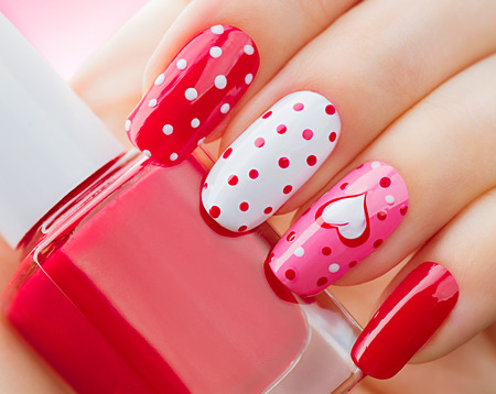 Photo for Valentines Day holiday style bright manicure with painted hearts and polka dots - Royalty Free Image