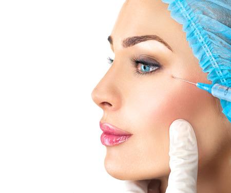 Photo pour Beauty woman gets facial injections. Cosmetology - image libre de droit