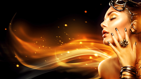 Photo for Burning woman head profile. Beauty fashion model girl with golden makeup - Royalty Free Image