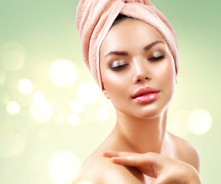 Photo pour Spa woman. Beautiful girl after bath touching her face - image libre de droit