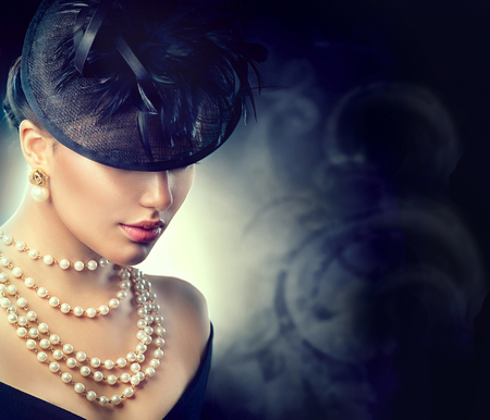 Photo for Retro woman portrait. Vintage style girl wearing old fashioned hat - Royalty Free Image