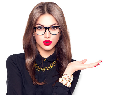 Photo pour Beauty fashion sexy girl wearing glasses showing empty copyspace for text - image libre de droit