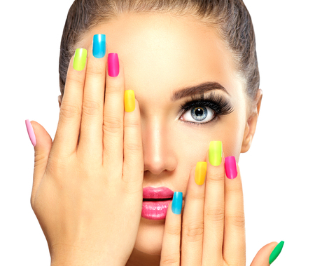 Photo pour Beauty girl face with colorful nail polish. Manicure and makeup - image libre de droit