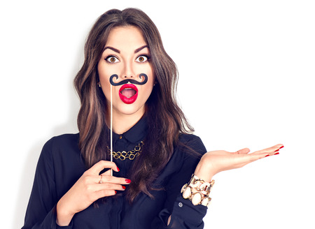 Foto de Surprised model gil holding funny mustache on stick - Imagen libre de derechos