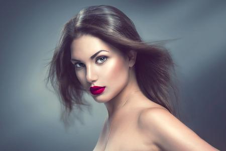 Photo pour Fashion model girl portrait with long blowing hair - image libre de droit