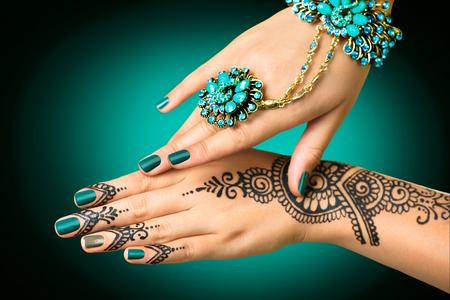Photo for Woman's hands with mehndi tattoo. Hands of Indian bride girl with black henna tattoos - Royalty Free Image