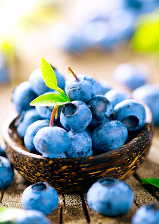 Photo for Freshly picked juicy blueberries in wooden bowl - Royalty Free Image