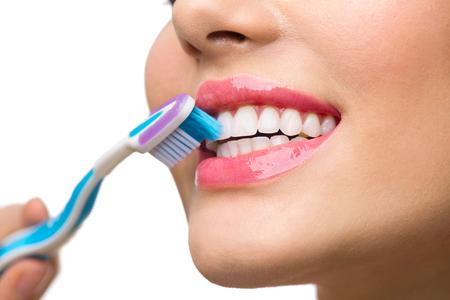 Photo pour Teeth brushing. Beautiful white healthy teeth - image libre de droit