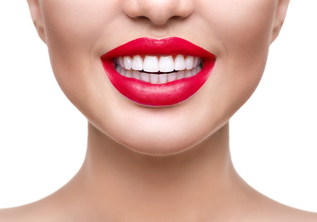 Foto für Teeth whitening. Healthy white smile closeup. Beautiful girl with red lips isolated on white - Lizenzfreies Bild