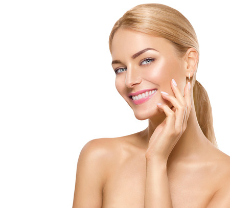 Photo for Beauty spa model girl touching face and smiling - Royalty Free Image