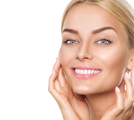 Photo for Beautiful spa girl touching her face and smiling - Royalty Free Image