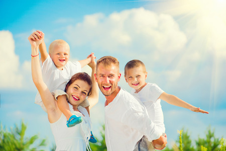 Photo pour Happy young family with two children having fun together - image libre de droit
