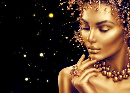 Photo pour Beauty fashion model girl with golden makeup, hair style isolated on black background - image libre de droit